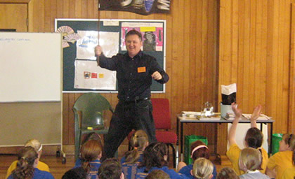 Michael Wagner with a flag at a school talk - who knows why!?